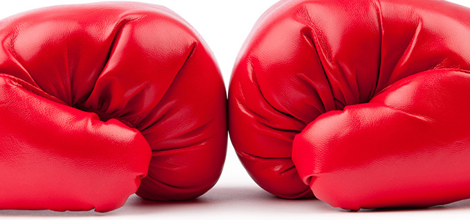 Red boxing gloves isolated on white; Shutterstock ID 80729629; PO: aol; Job: production; Client: drone